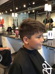 fun textured boy haircut with short sides and long layered top