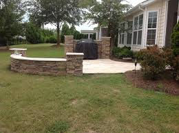 Building A Raised Patio With Retaining Wall by Fort Mill Sc Deck Builder Patio Builder Pergola Builder Porch