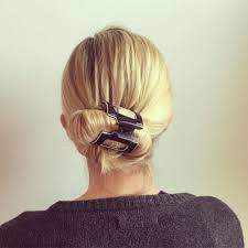jaw clip low bun roll hairstyle using a jaw clip and accessories