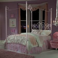 twin metal canopy bed with clear post finials by standard
