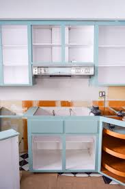what of paint to use inside kitchen cabinets how to paint your plywood kitchen cabinets pmq for two