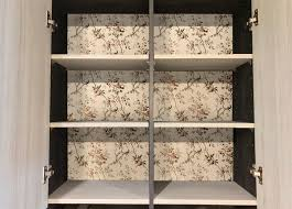 how to make the inside of cabinets look 6 creative ideas for decorating cabinet interiors lovetoknow
