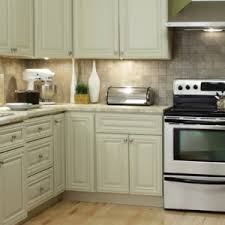 simple kitchen with wooden white painted kitchen cabinet design