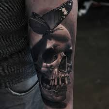 awesome scary realistic skull with butterfly tattoo on lower