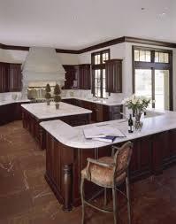 dark wood kitchen island kitchen pendant light oven barstools cabinets americana black