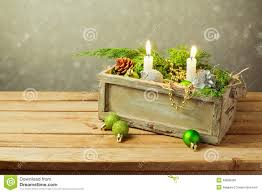 wooden box with christmas decorations and candles over dreamy