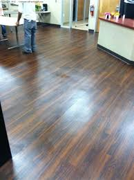 stripping and waxing a wood floor image