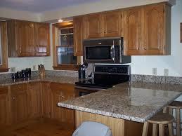 oak kitchen cabinets and granite countertops our oak kitchen makeover