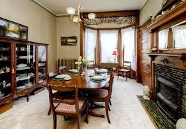 formal dining room with fireplace hooked on houses