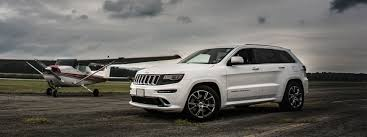 gray jeep grand cherokee with black rims jeep grand cherokee accessories floor mats cargo trays luggage