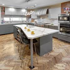 have a look at this unusual cut of the kitchen island made of