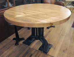 refurbished round butcher block table with heavy cast iron base refurbished round butcher block table with heavy cast iron base 4