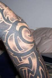 tripped out tribal arm sleeve tattoo
