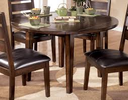 round drop leaf dining table larchmont round dropleaf dining table by signature design tenpenny