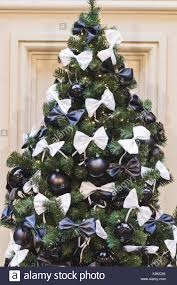 tree decorated in black and white style with balls and