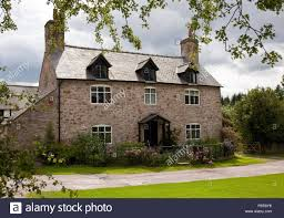House Dormers Photos Rough Stone House With Dormer Windows And Surrounding Flowers And