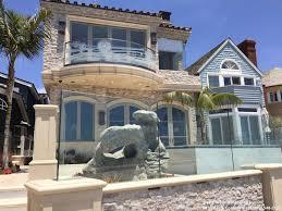 custom curved glass balcony railing installation in corona del mar