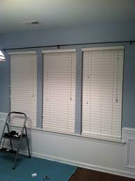 decorating window decor with white levolor blinds on blue wall