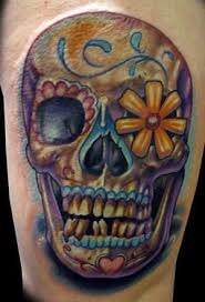 a grinning sugar skull tattoo design with a daisy flower in the