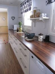 kitchen with white cabinets and wood countertops 25 butcher block countertops for your kitchen shelterness