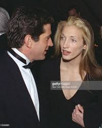 john f kennedy jr chats with his girlfriend carolyn besse