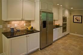 white kitchen cabinets stone backsplash home design ideas kitchen cabinetry brick floor installation in traditional one