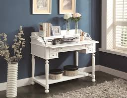 small white writing desk with drawers and ample open shelf