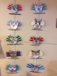 cd owls i made with plasticware both sides have owl faces also