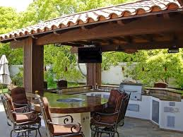 kitchen ornate iron chairs and circular outdoor kitchen cabinet