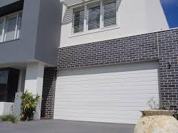 external finish to rear black bricks white grout with white trim
