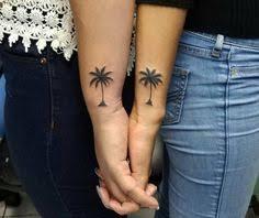 small palmtree palm tree tattoos on finger and wrist palm tree