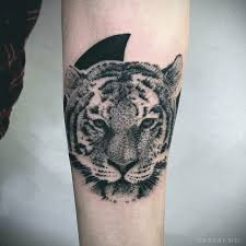 small stippling style black ink tiger on forearm