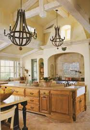 tuscan kitchen with exposed beam ceiling and rustic chandeliers