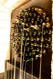 must make a wine bottle water feature think it of using an old