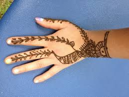 simple henna tattoo on hand