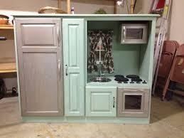 diy play kitchen from an upcycled entertainment center