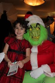 she u0027s so cute she melted the grinch u0027s heart brunch with santa
