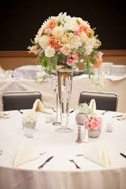 wedding centerpiece with blush and peach roses white hydrangea