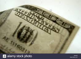 close up hundred dollar bill upper right corner 100 the united