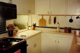 interior mid century modern kitchen design with black range hood