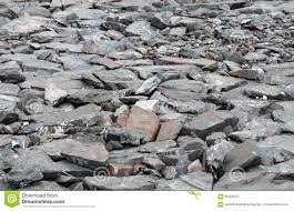 perspective view of grunge gray natural stone on the ground for