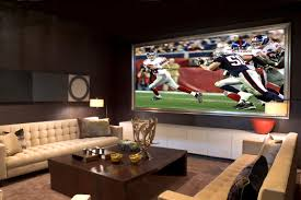 cool home theater rooms home theater showing large lcd on the wall and cream fabric chairs
