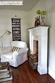 Artificial Logs For Fireplace by Create A Faux Fire Look Use A Crate Or Make A Box From Barn Wood