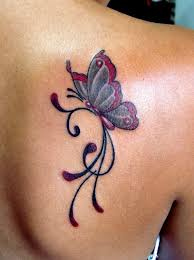 butterfly with open wings on back shoulder
