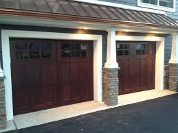 this steel garage door features a sonoma panel design white paint
