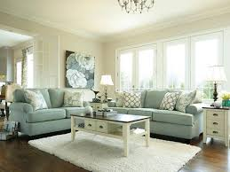 cozy living room design living room gray sofa gray recliners white shelves brown chairs