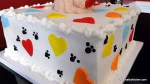 kalico kitchen first birthday cakes dog reading book dog bone