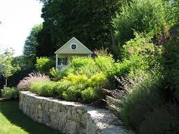 a playhouse and garden built for children hgtv
