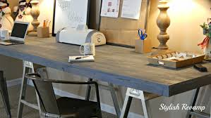 furniture sawhorse desk with armchair and table lamp plus scissors