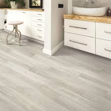 can i put cabinets on vinyl plank flooring mohawk home driftwinds pine waterproof rigid 5mm thick luxury vinyl plank flooring 1mm attached pad included